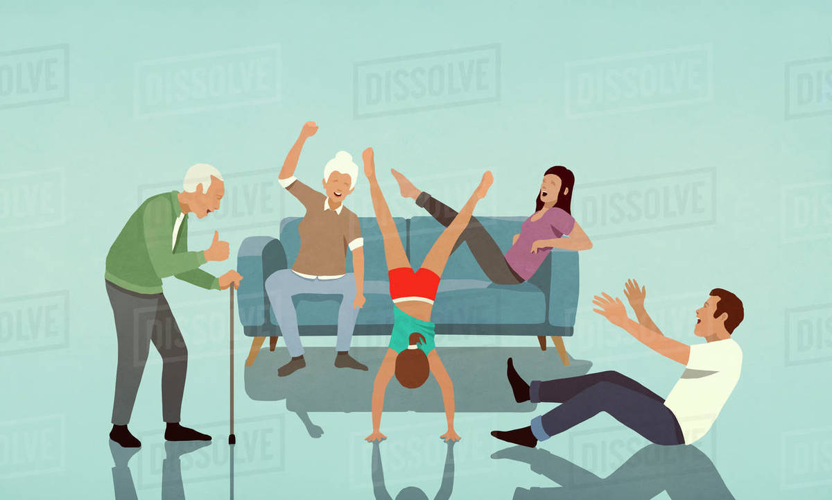 Happy multi-generation family cheering for girl doing handstand in living room Royalty-free stock photo