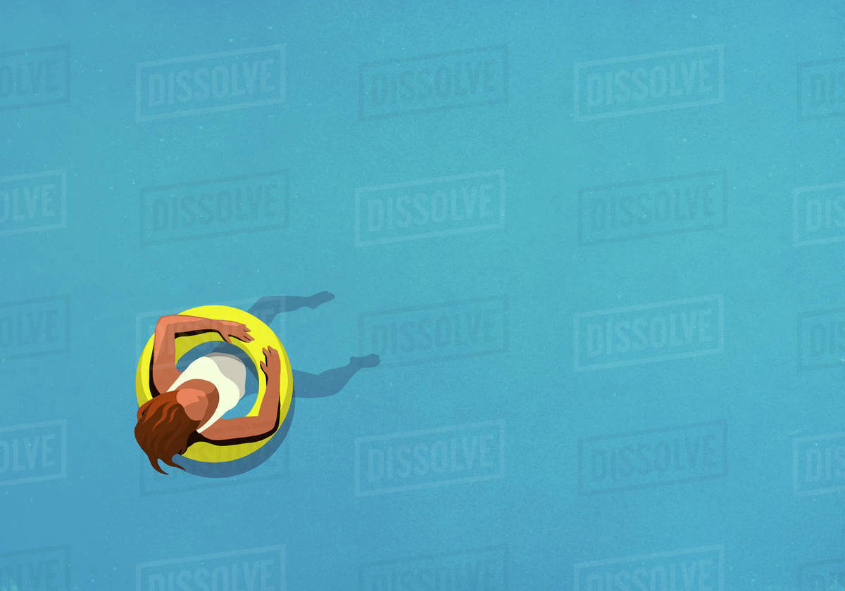 View from above woman in inflatable ring floating in swimming pool Royalty-free stock photo