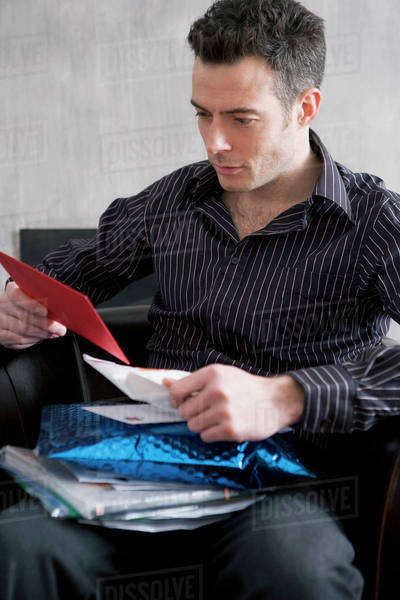 A man looking through his mail Royalty-free stock photo